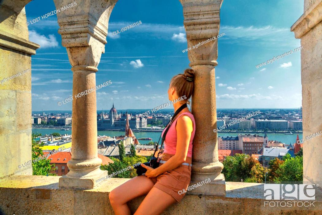 Stock Photo: Mid adult woman looking at view of Buda from the Fisherman's Bastion, Budapest, Hungary.
