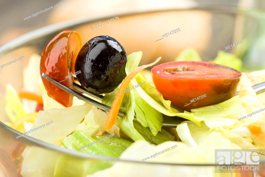 Photo de stock: macro shot Fork with lettuce and olives.