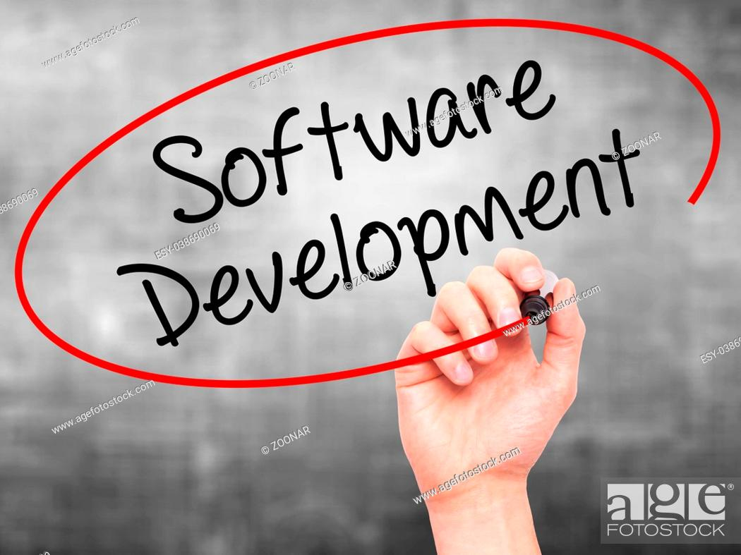 Stock Photo: Man Hand writing Software Development with black marker on visual screen.