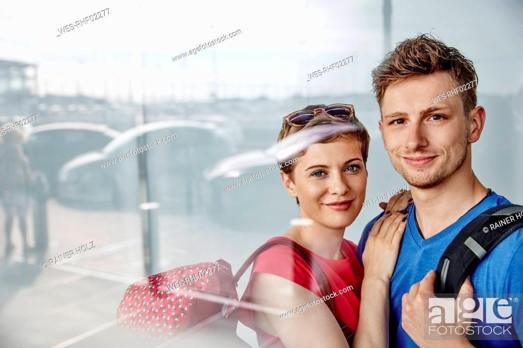 Stock Photo: Portrait of smiling couple at the airport.