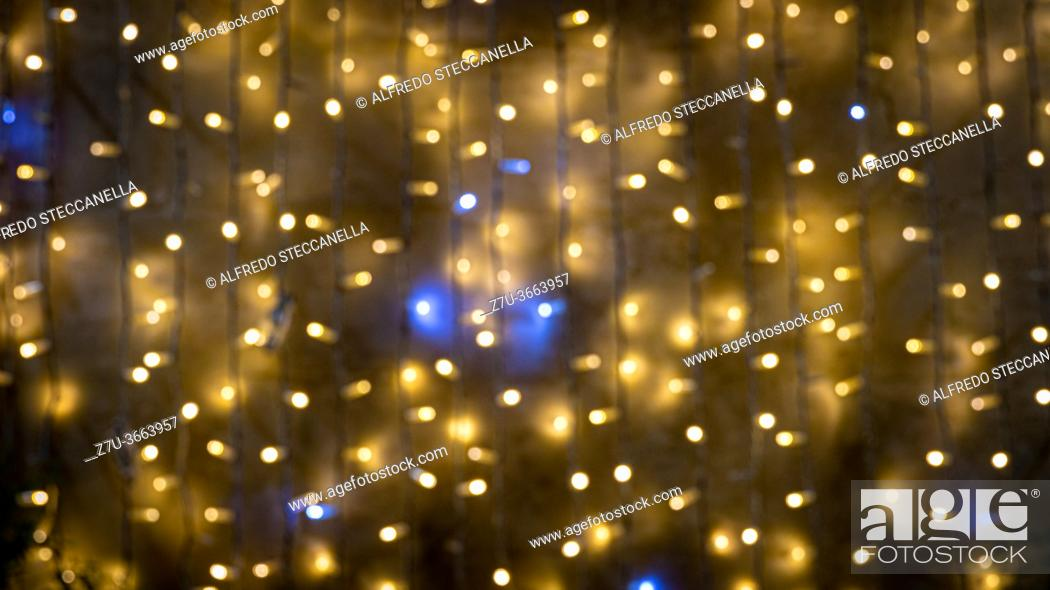 Stock Photo: Defocused selected christmas glittering lights.