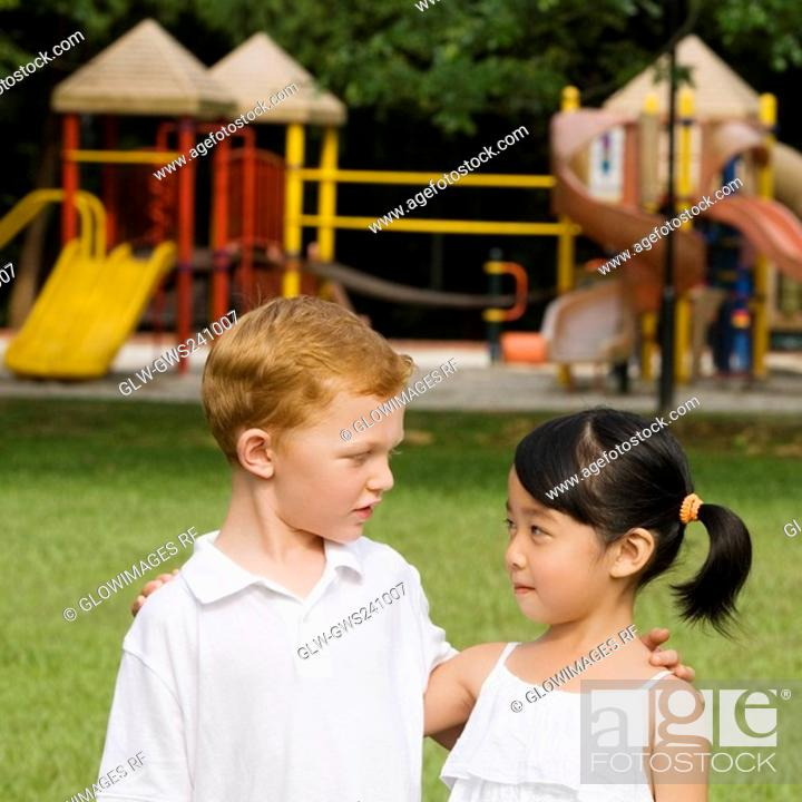 Stock Photo: Close-up of a boy and a girl looking at each other.