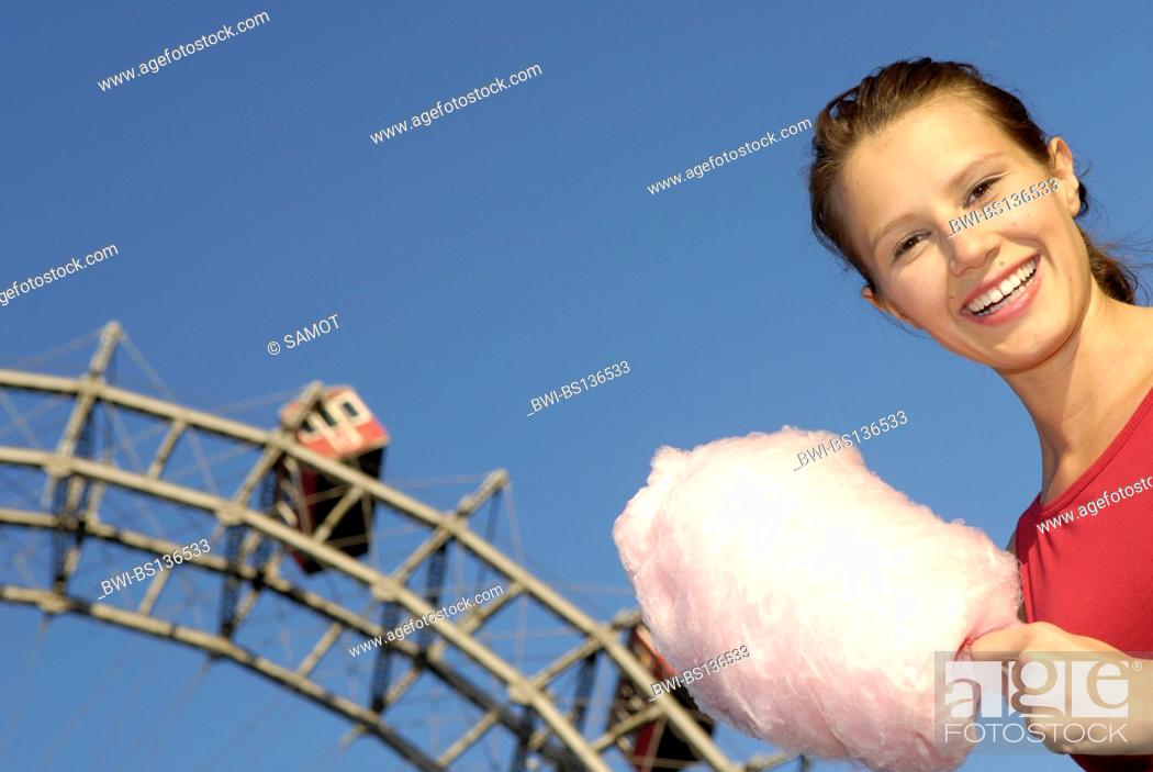 Stock Photo: amusement park Prater Vienna, young woman with candy floss, Austria, Vienna.