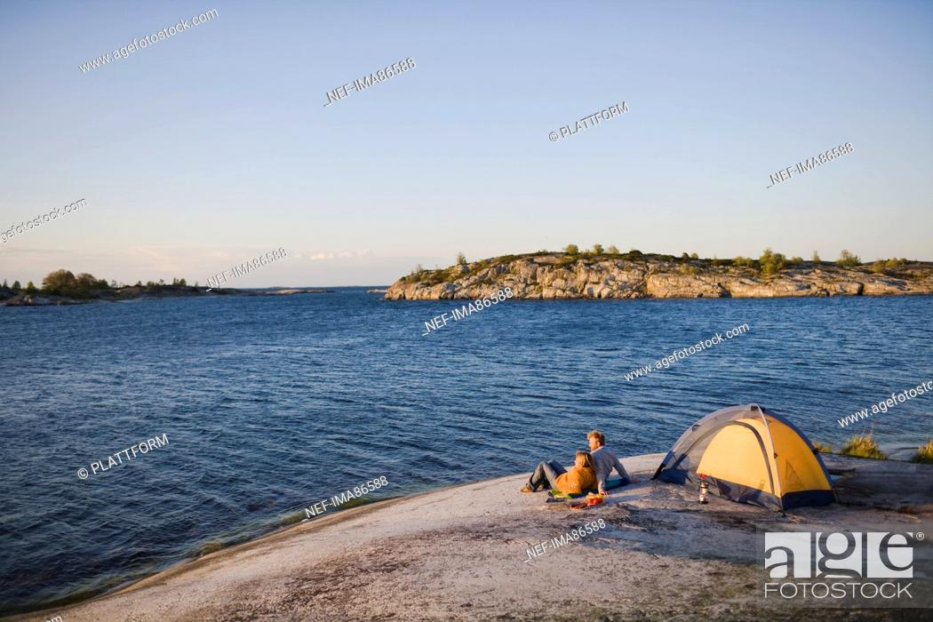 Stock Photo: Couple camping by sea.