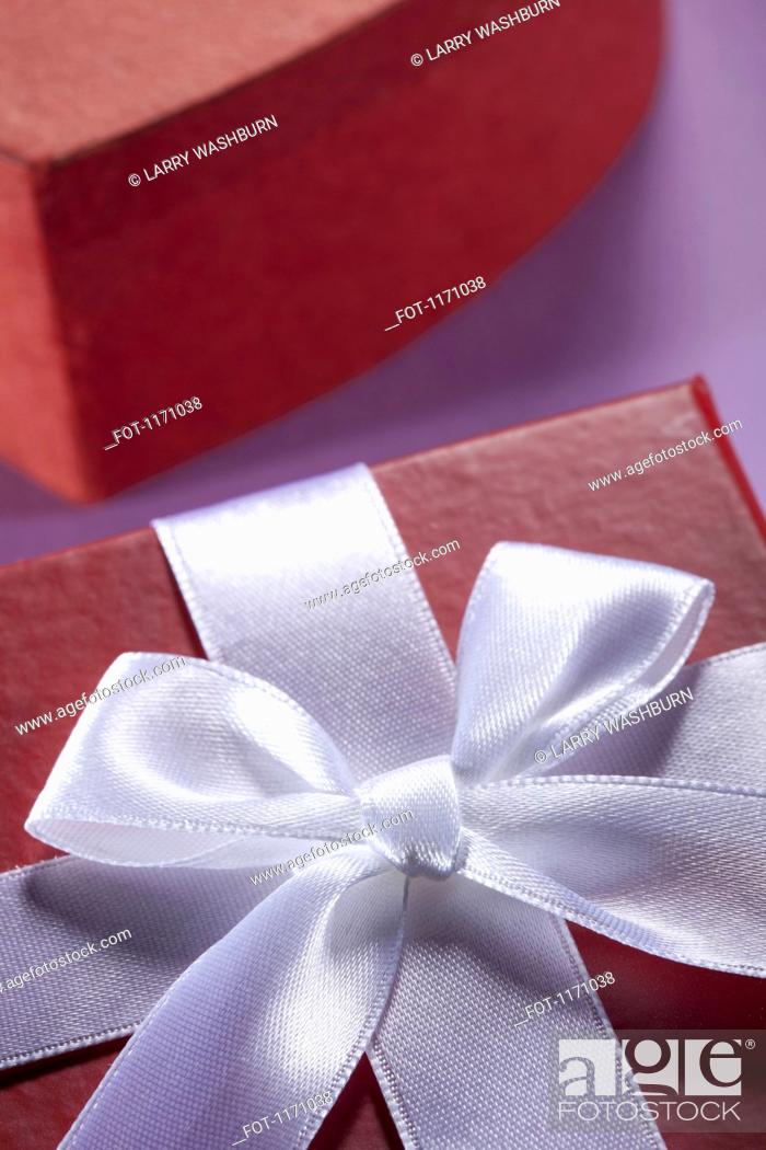 Stock Photo: Close-up of a white bow and ribbon on a gift box.