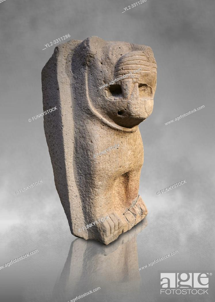 Stock Photo: Hittite monumental relief sculpture of a lion. Adana Archaeology Museum, Turkey. Against a grey art background.