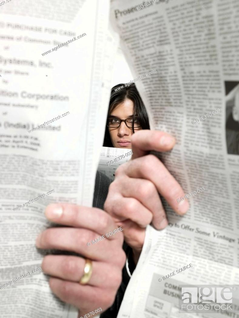 Stock Photo: Businessmen and newspapers.