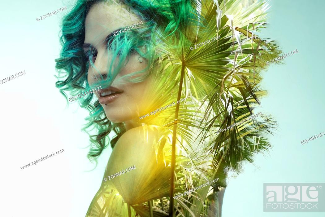 Stock Photo: double exposure, beautiful woman with green hair fused with wild and tropical jungle.