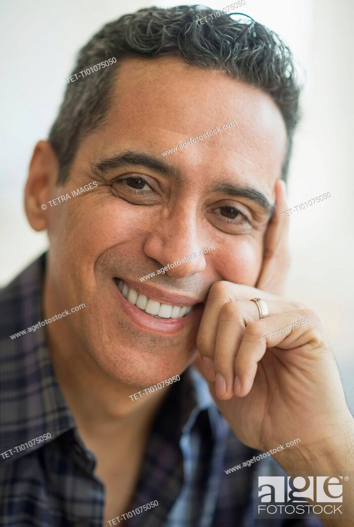 Stock Photo: Portrait of smiling mature man.