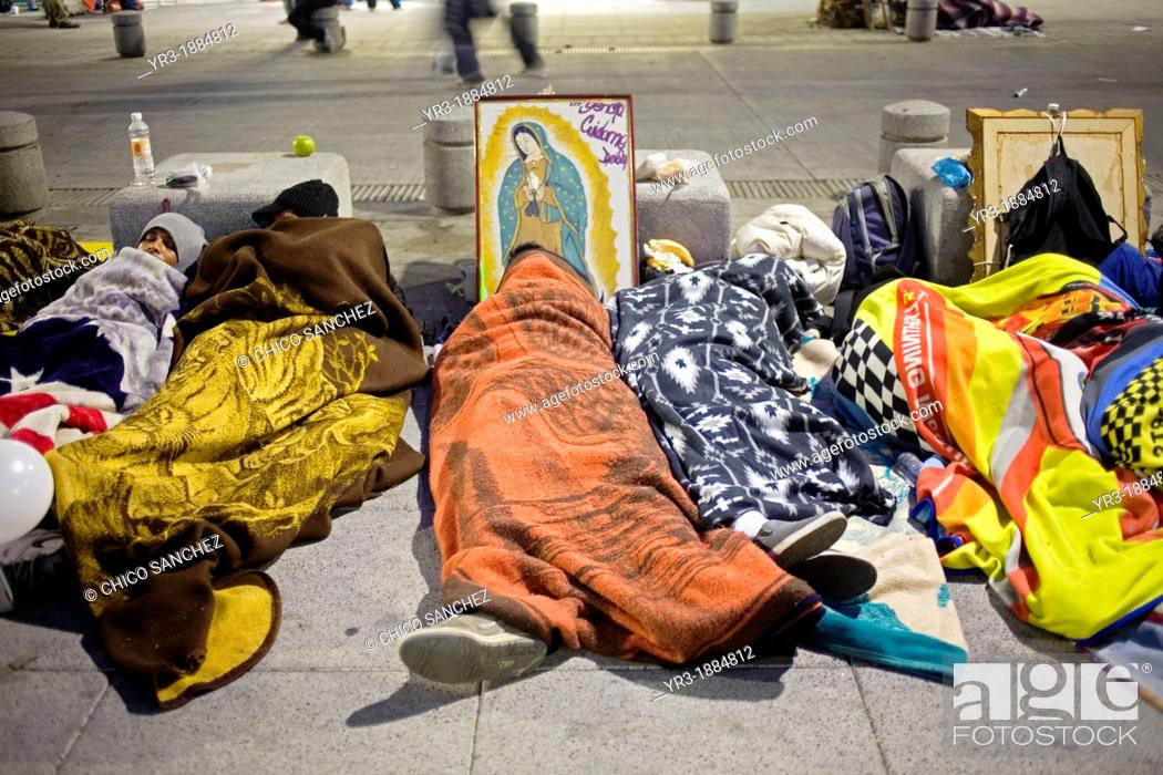 Stock Photo: Pilgrims sleep in the street by an image of the Our Lady of Guadalupe virgin in Mexico City, December 11, 2010  Hundreds of thousands of Mexican pilgrims.