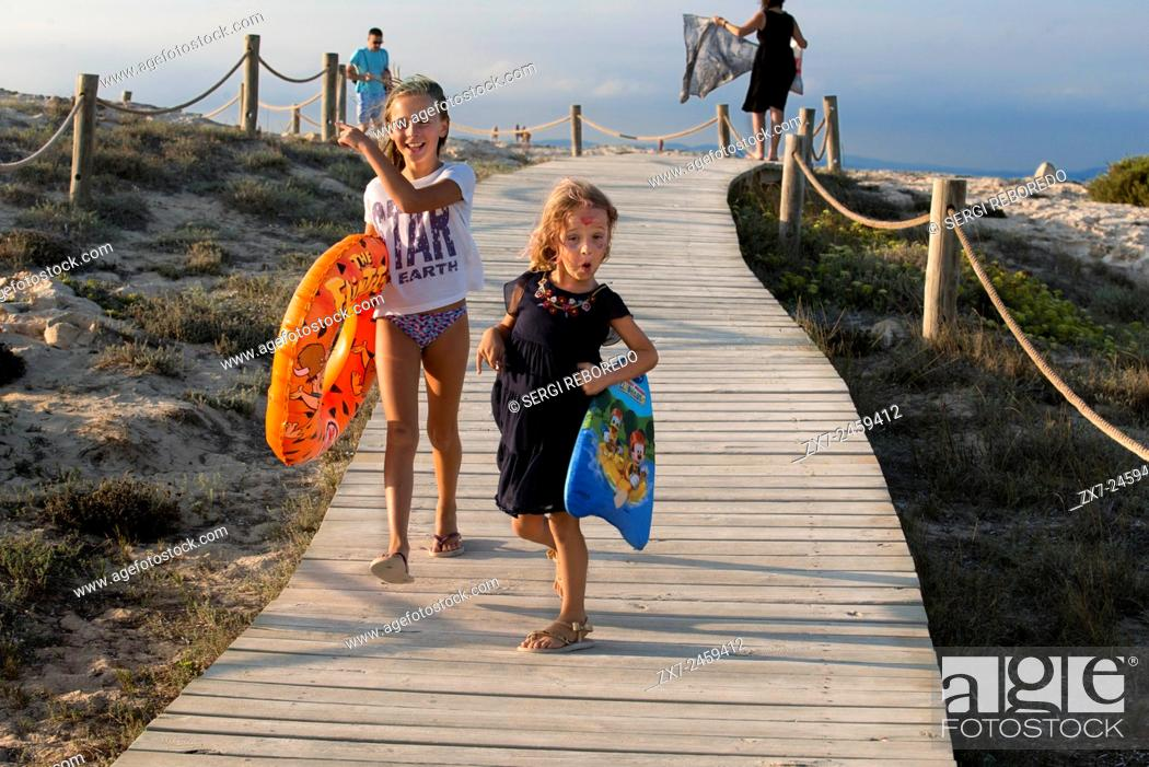 Stock Photo: Sa Roqueta Beach and Ses Illetes Beach, Balearic Islands, Formentera, Spain. Funy girls with floats.