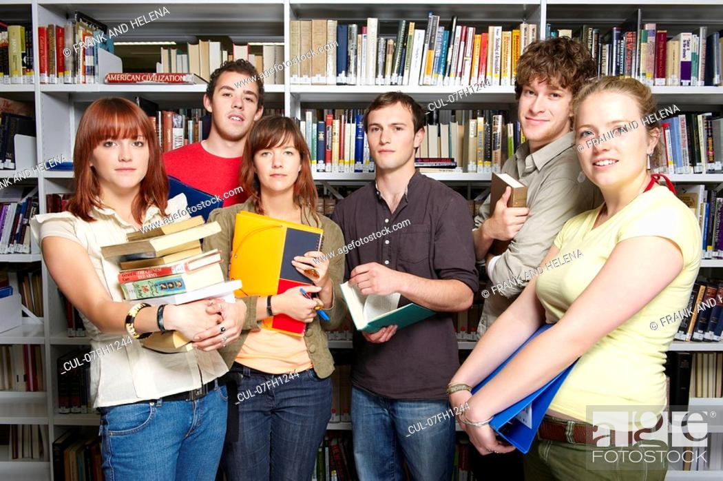 Stock Photo: Group of young people in a library.