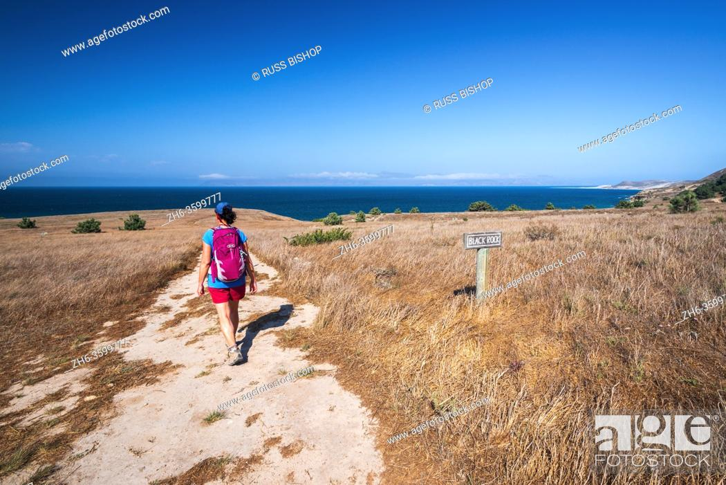 Stock Photo: Hiker at Black Rock Point, Santa Rosa Island, Channel Islands National Park, California USA.