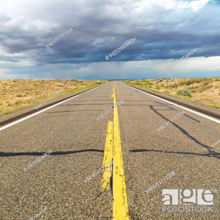 Stock Photo: Empty two lane highway leading to desert horizon.
