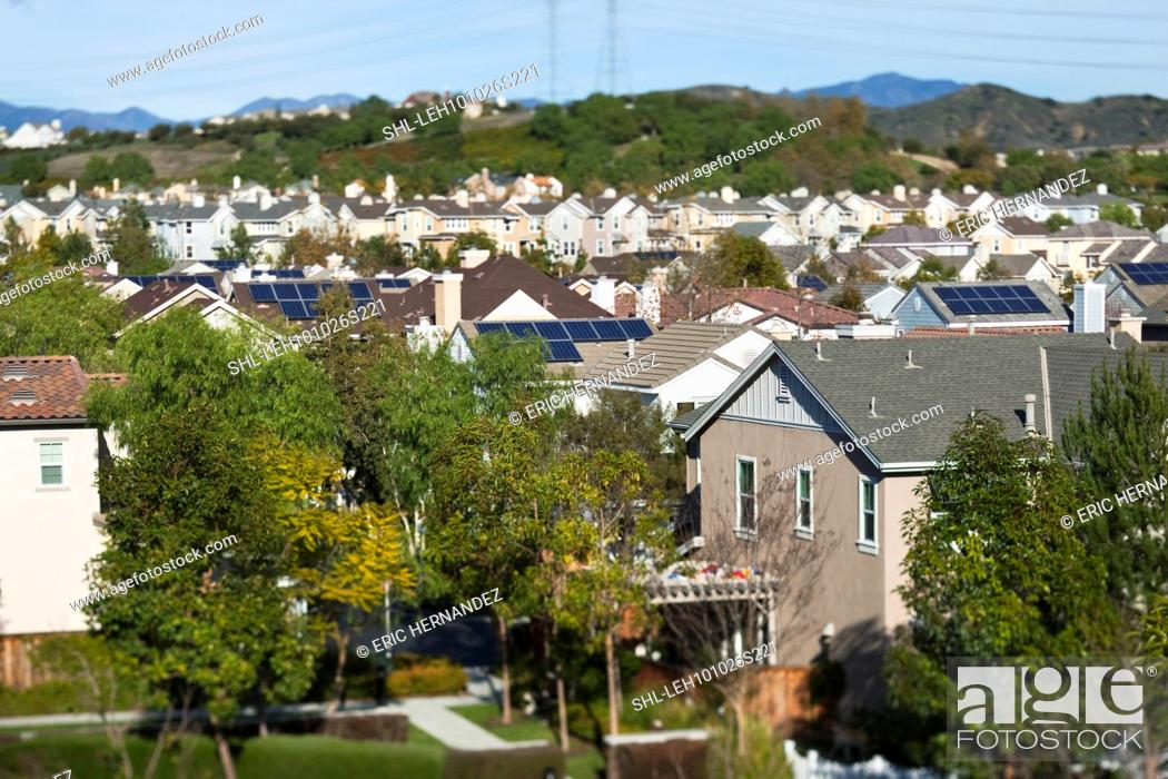 Stock Photo: Rooftop view of community with solar panels.