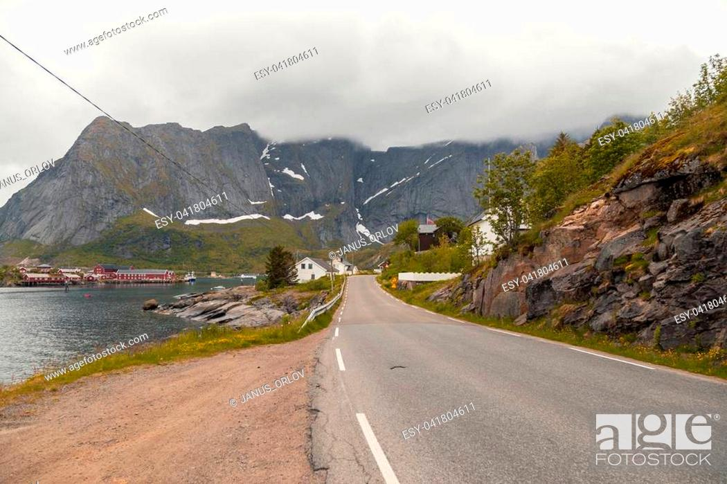 Stock Photo: View of a small village surrounded by mountains.