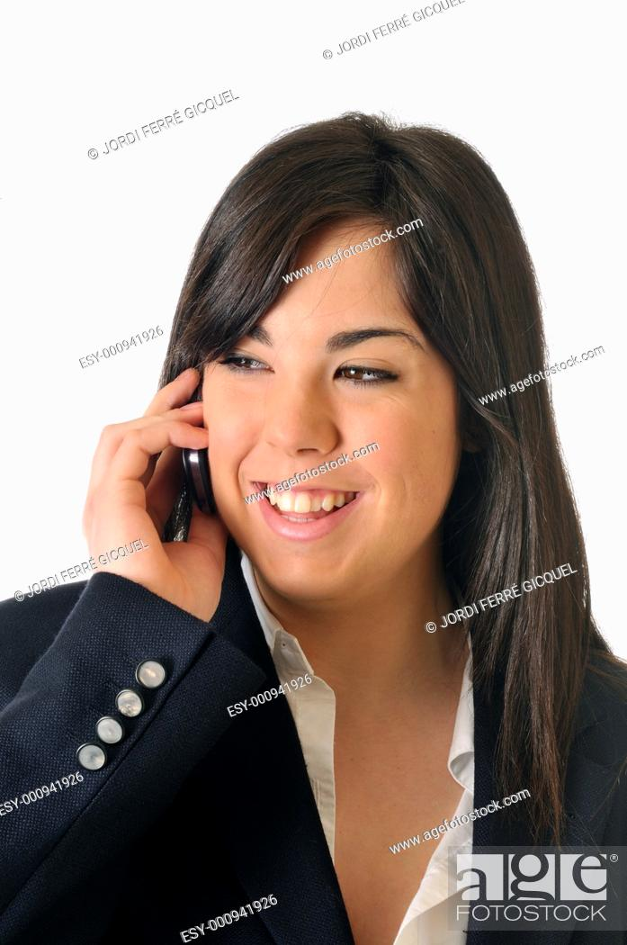 Stock Photo: Young woman talking on the phone smiling.