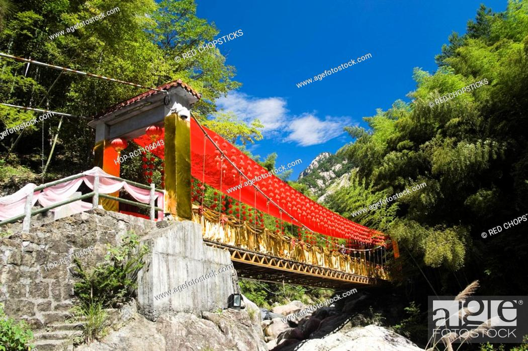 Stock Photo: Low angle view of a bridge decorated with Chinese lanterns, Emerald Valley, Huangshan, Anhui Province, China.