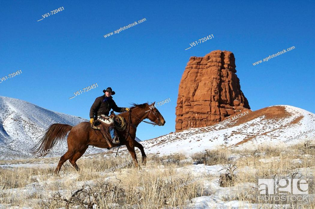 Stock Photo: Cowboy out for a ride in winter, Shell, Wyoming. Usa.