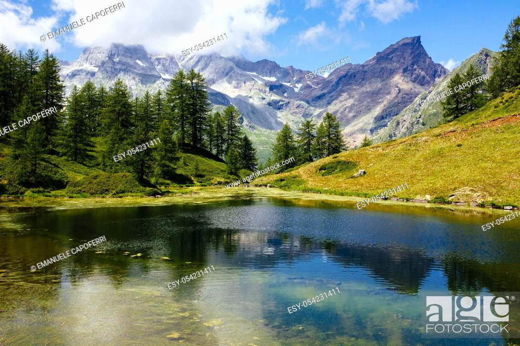 Stock Photo: Alpine lake and mountain landscape, Alpe Devero, Italy.