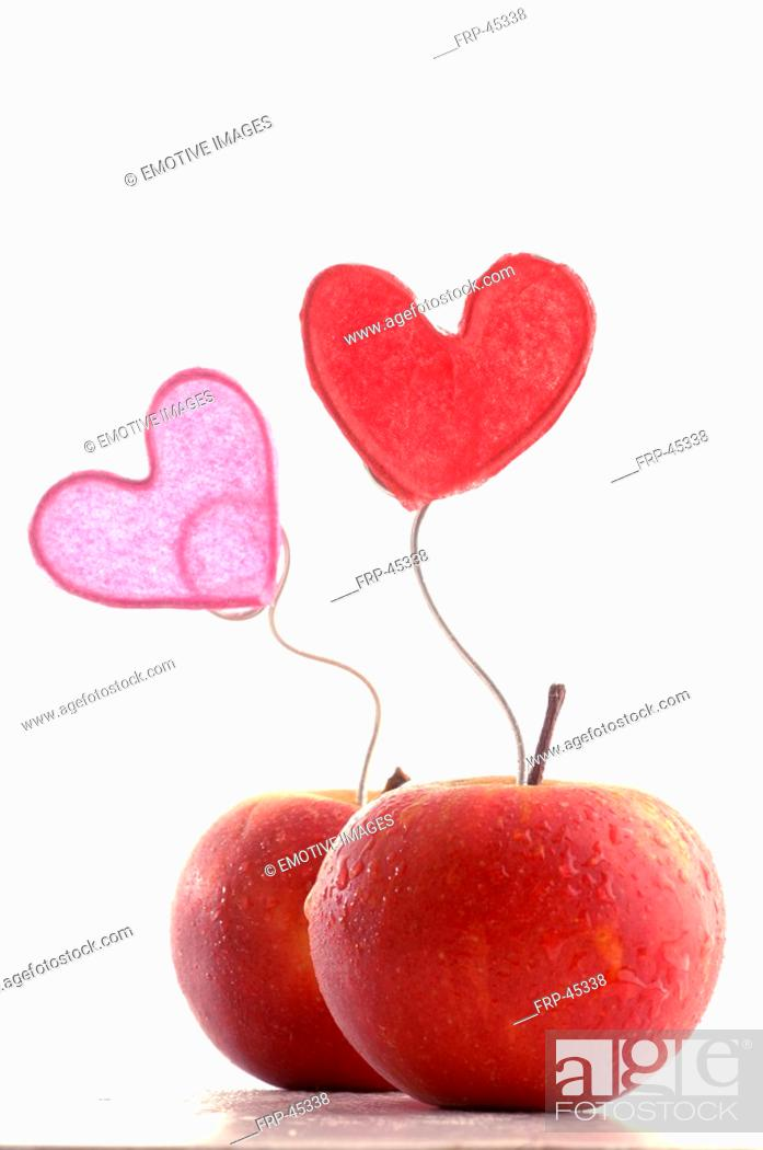 Stock Photo: Apples with decorative hearts.