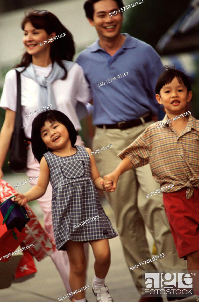 Stock Photo: Parents walking with their son and daughter.