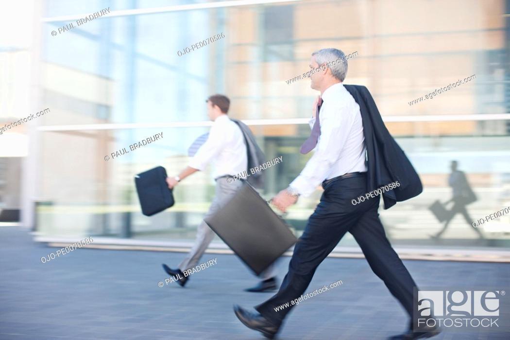 Stock Photo: Businessmen walking outdoors.