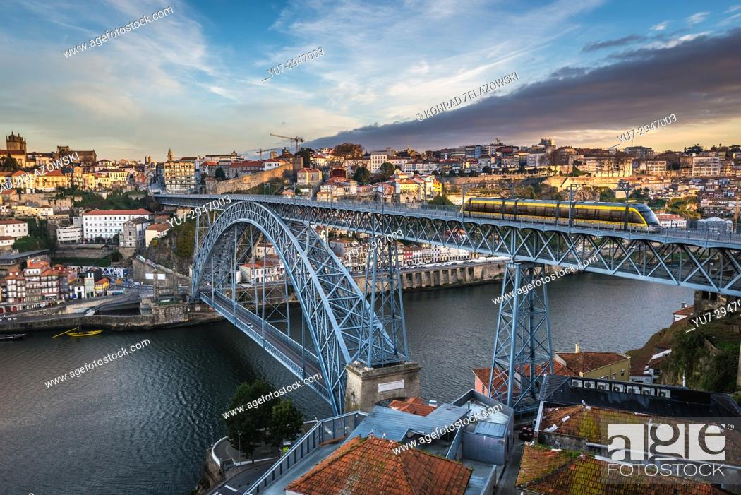 Stock Photo: View on famous Dom Luis I arch bridge between cities of Porto and Vila Nova de Gaia cities, Portugal.