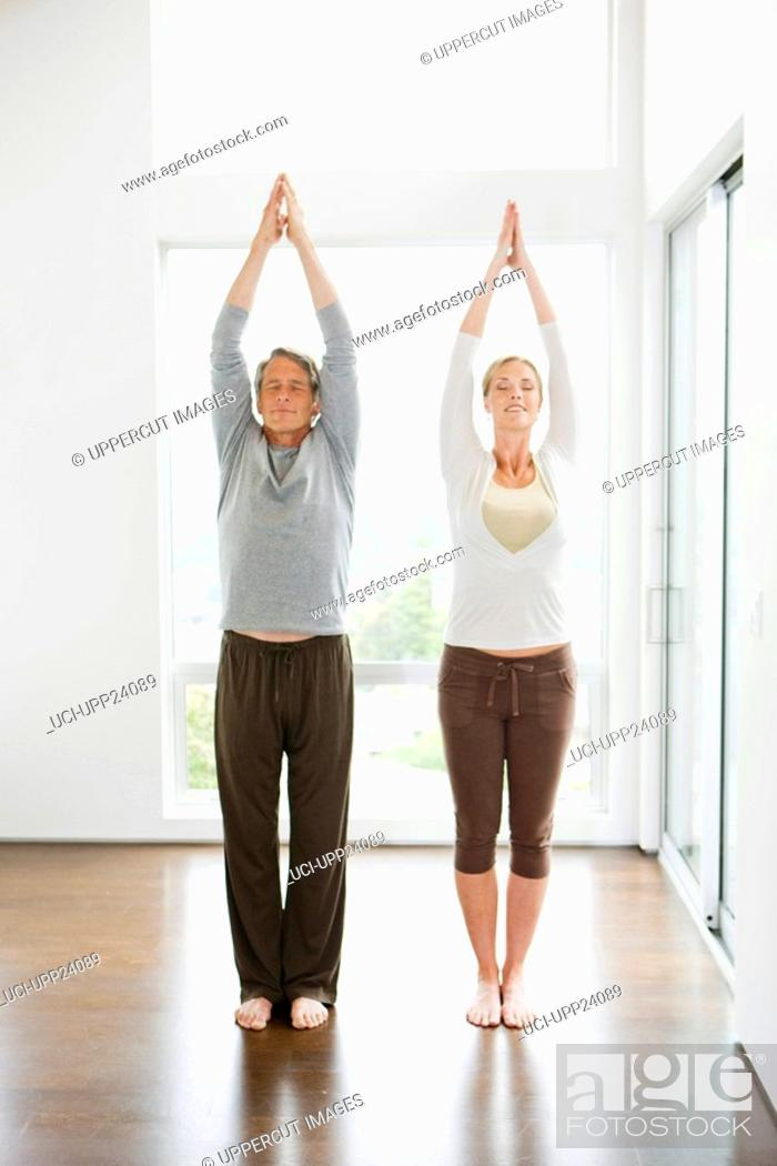 Stock Photo: Couple standing in yoga pose.