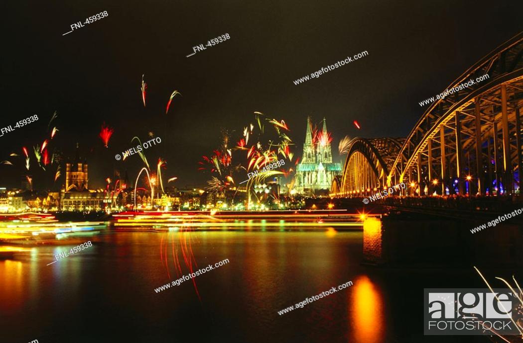 Stock Photo: Fireworks near bridge at night.