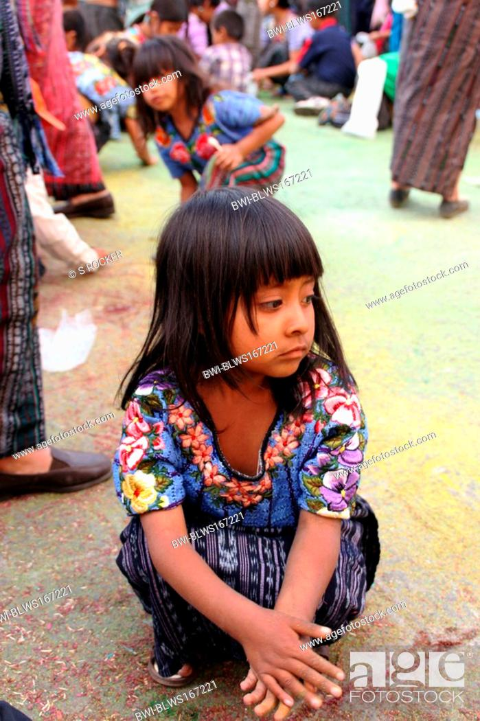 Stock Photo: Mayan child with confetti in the middle of a Maya procession in Santiago de Atitlan, Guatemala, Atitlansee, Santiago de Atitlan.