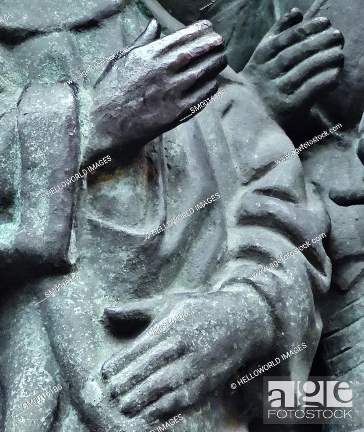 Stock Photo: Three hands on bronze sculpture.