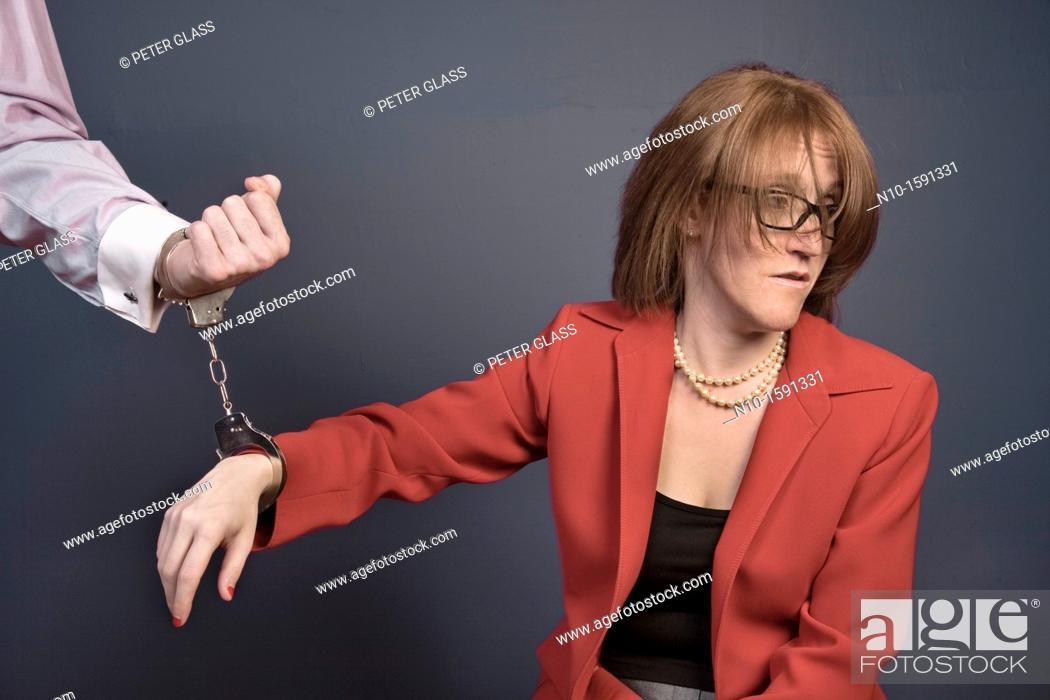Stock Photo: Woman handcuffed to her husband's wrist.