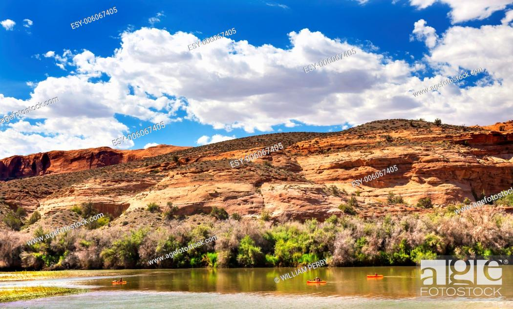 Stock Photo: Orange Boats Colorado River Reflection Green Grass Red Rock Canyon Outside Arches National Park Moab Utah USA Southwest.