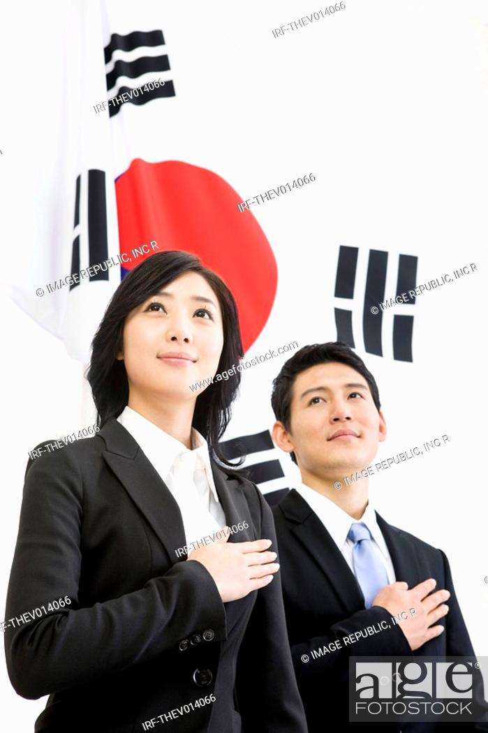 Stock Photo: businessman and businesswoman in front of Korean flag, Taegeukgi.