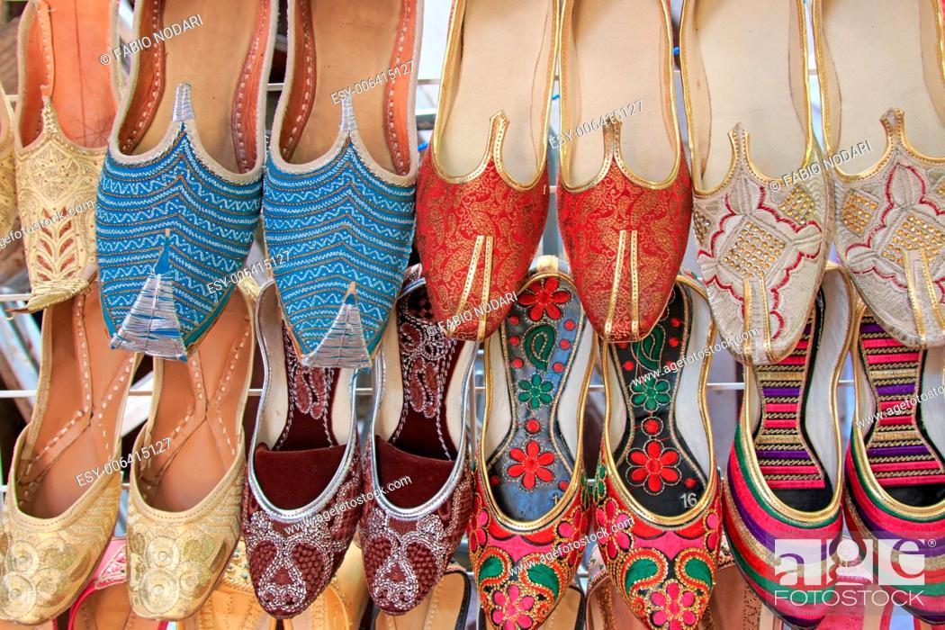 Stock Photo: Arabian Slippers - Intricate beadwork adorn these arabian slippers seen at a market in Dubai.