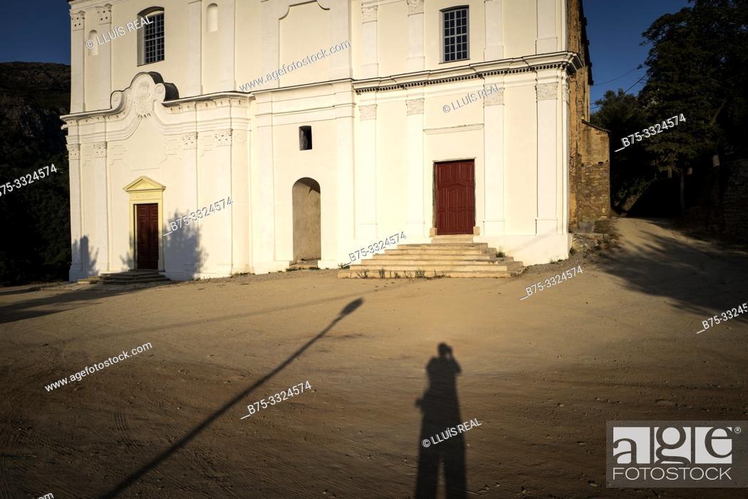 Stock Photo: Photographer's selfie photographing the Iglesia de San Giovanni Evangelista (siglo xvi) Santo- Pietro-de Tenda, Corsica, France, Europe.