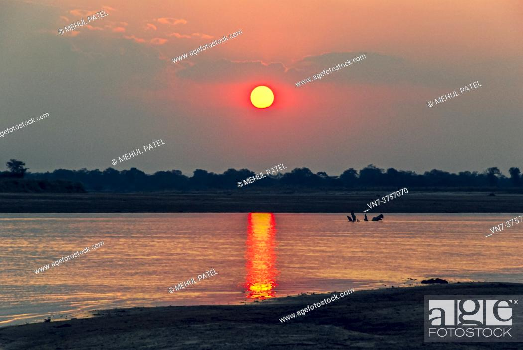 Stock Photo: Sunsetting by river in South Luangwa National Park, Zambia, Africa.