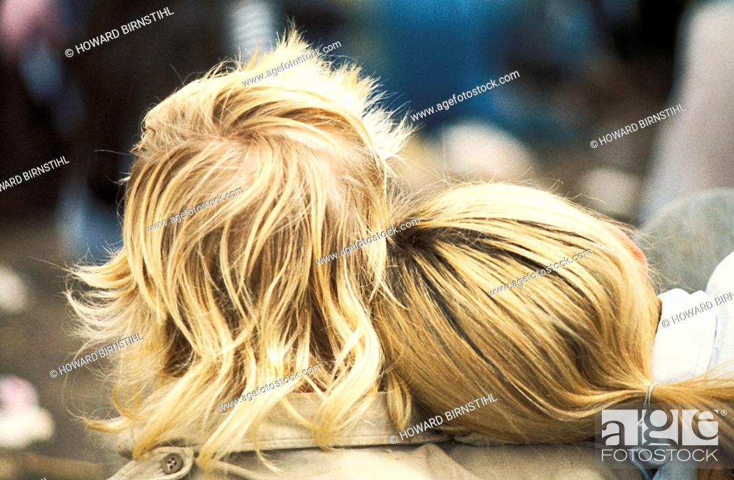 Stock Photo: close up back view of a a blond couple with the girl's head on the boy's shoulder.