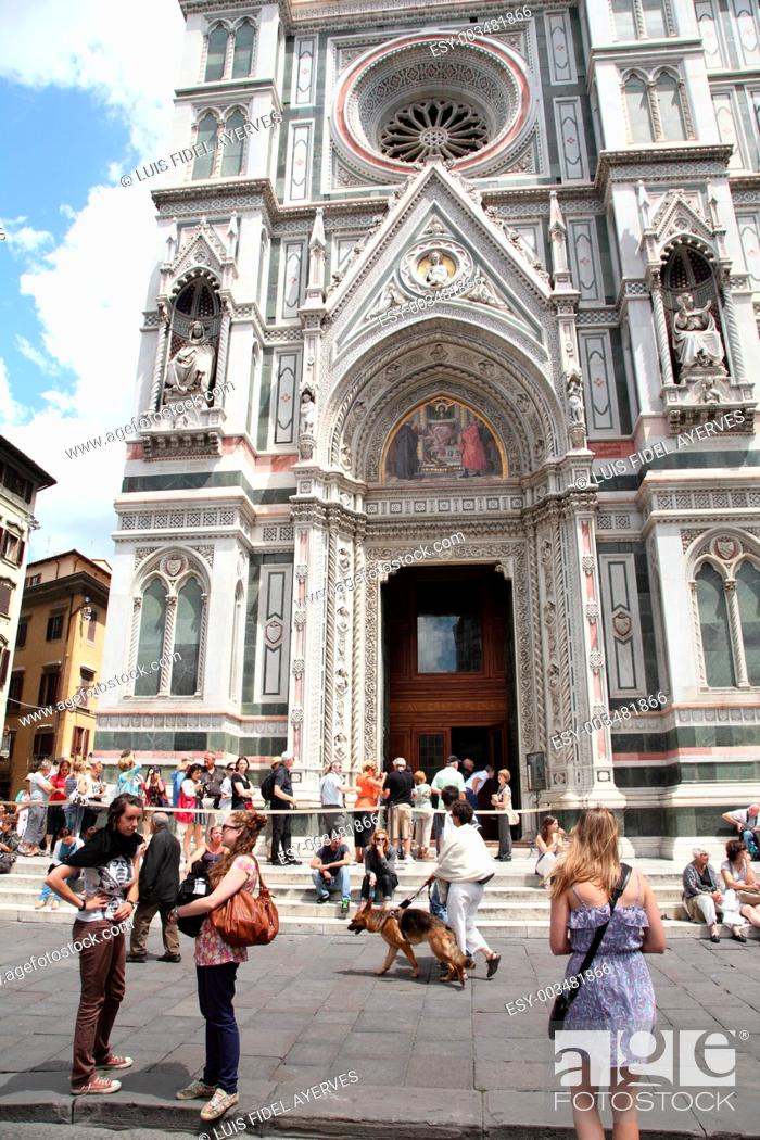 Stock Photo: Tourists in front of the facade of Santa Maria del Fiore cathedral, Piazza del Duomo, Florence, Italy.