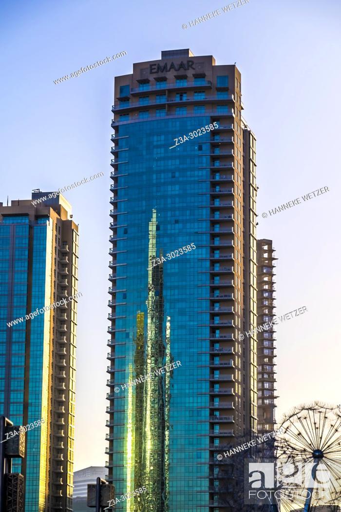 Stock Photo: Emaar Properties Tower reflected in Emaar skyscrapers in Dubai.