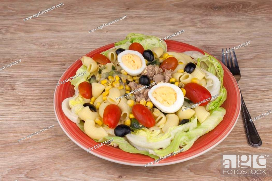 Stock Photo: Refreshing summer dish, pasta with tuna, vegetables, olives and egg. Healthy food for athletes.