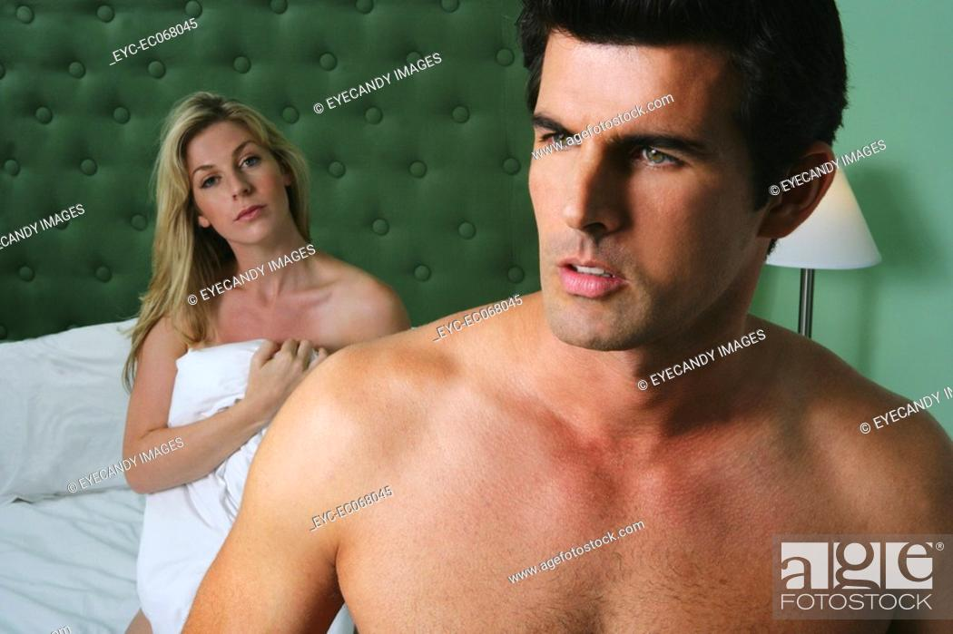 Stock Photo: Distracted young man with sexy woman behind.