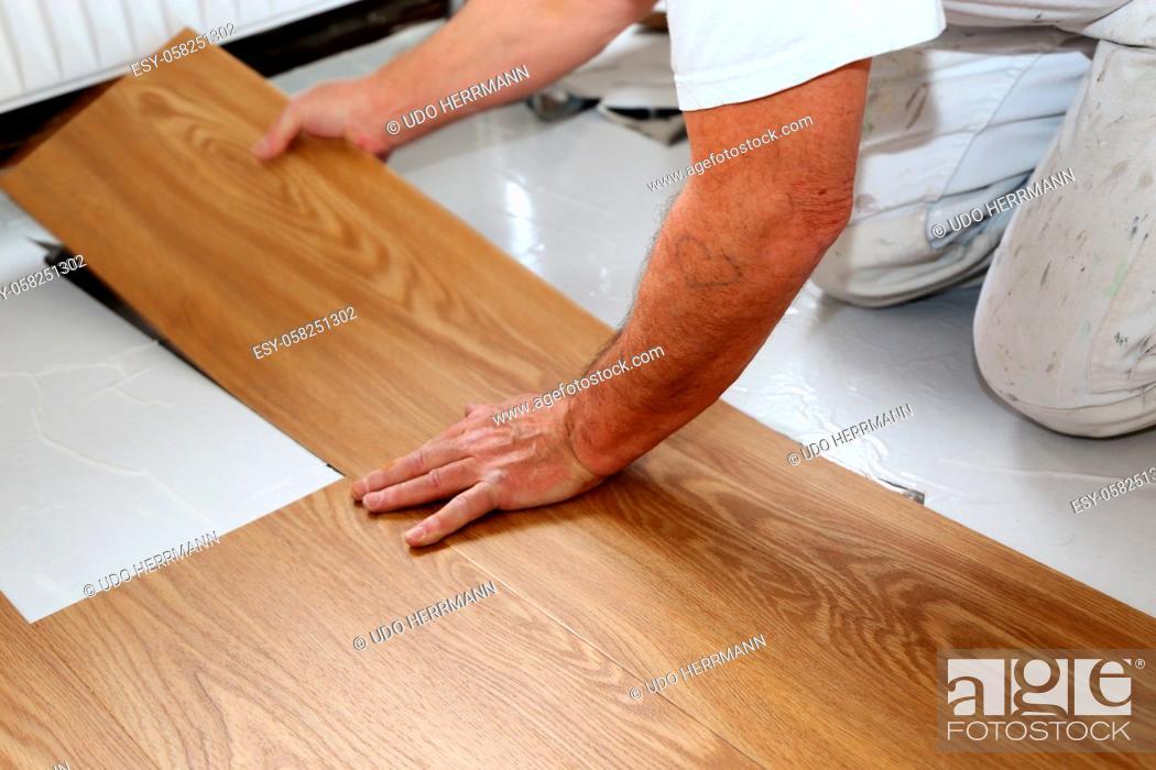 Stock Photo: Professional installation of vinyl flooring or pvc flooring.