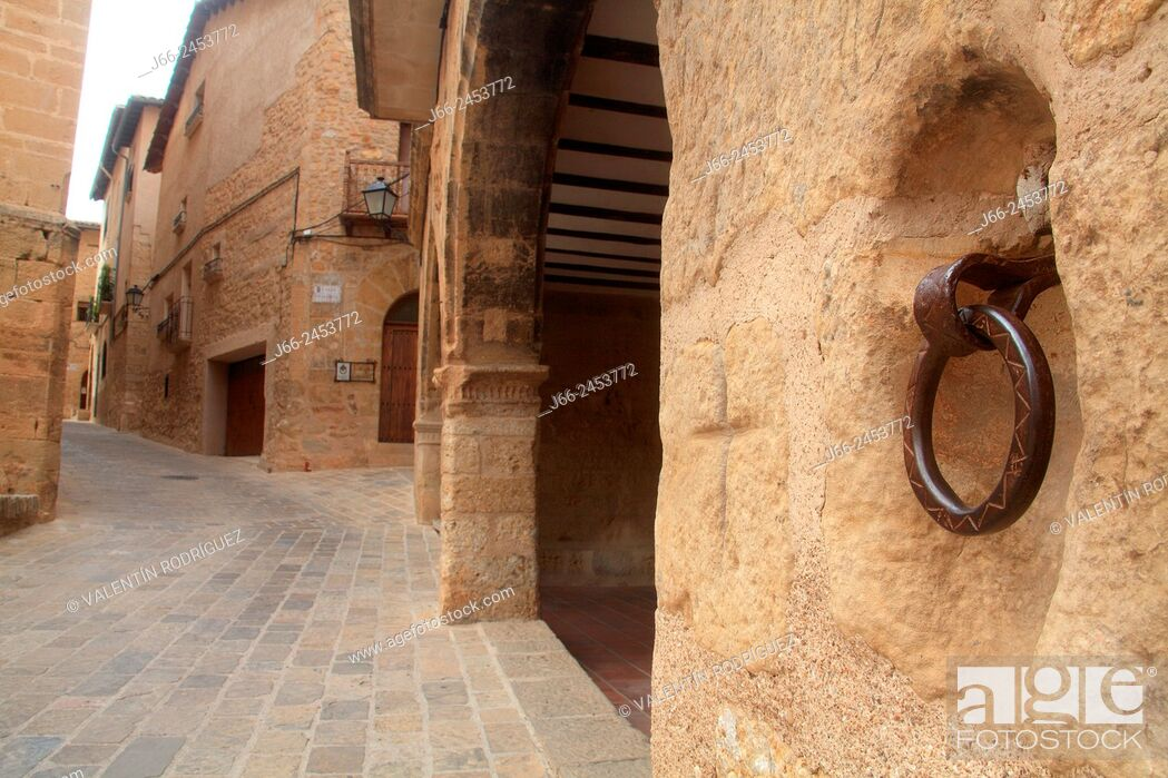 Stock Photo: Belmonte de San José street with the facade of the town hall building firtly. Mezquín region. Low Aragon. Teruel. Spain.