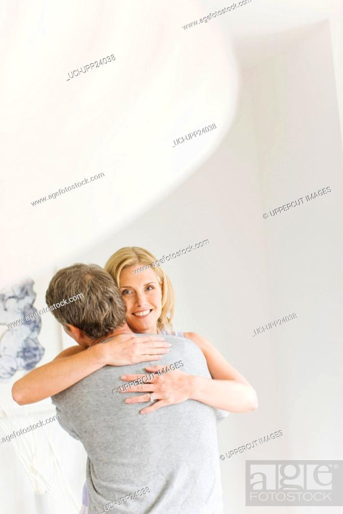 Stock Photo: Portrait of couple hugging.