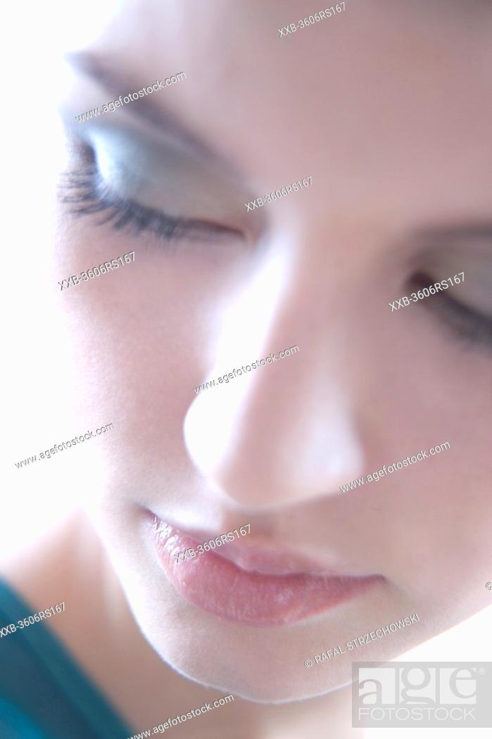 Stock Photo: woman with blue eye shadow.