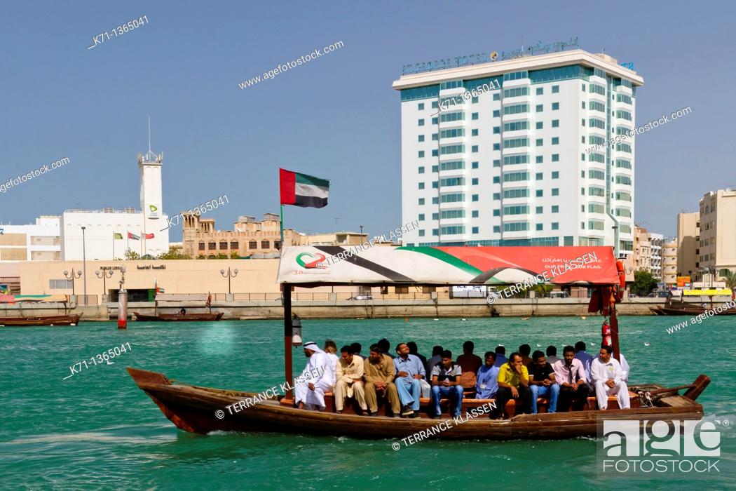 Stock Photo: Small dow boats offer water taxi service along Dubai Creek in Dubai, UAE, Persian Gulf.