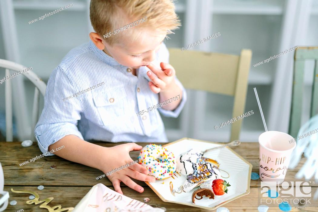Stock Photo: Boy at table.