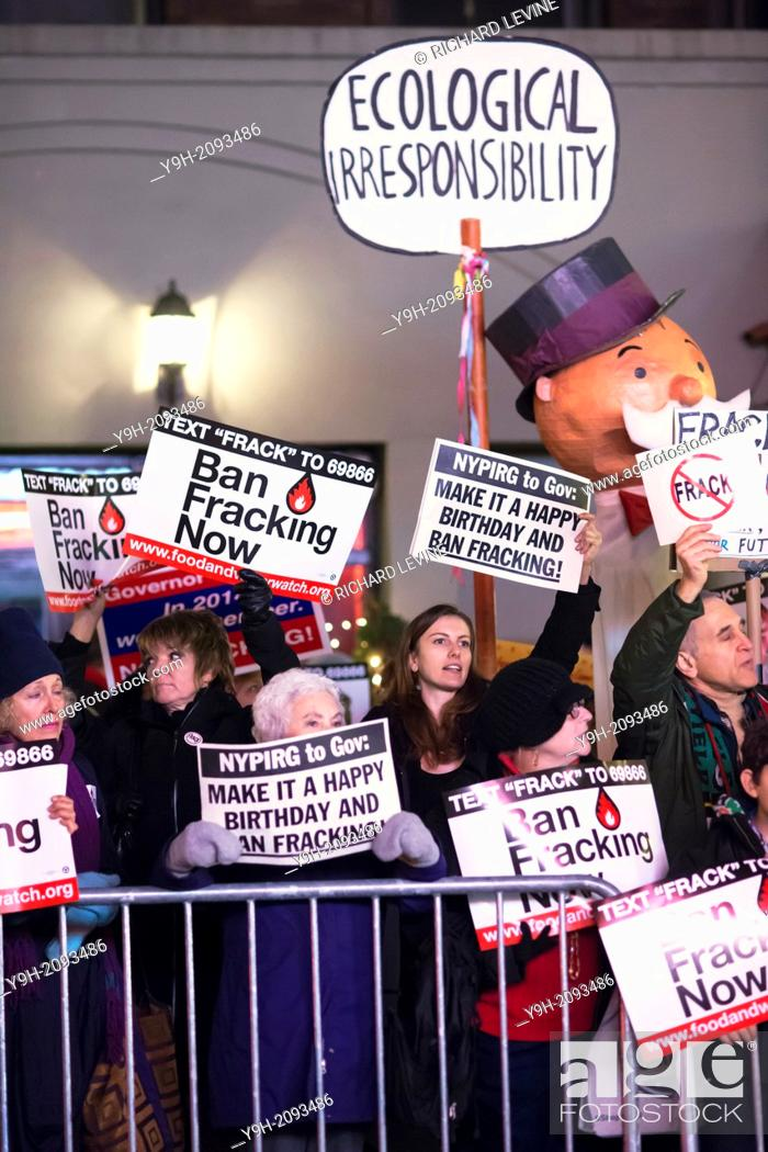 Stock Photo: Hundreds of environmental activists protest in front of Roseland Ballroom in New York where NYS Gov. Andrew Cuomo is holding his birthday fundraiser featuring.
